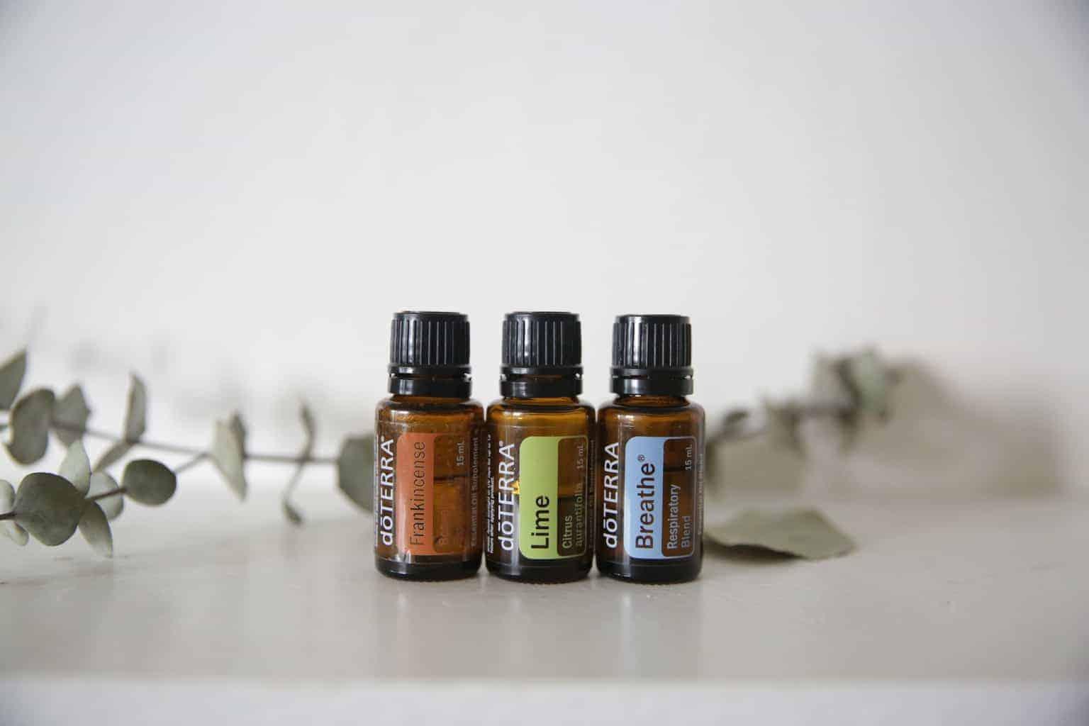 3 bottles of DoTERRA essential oils on table