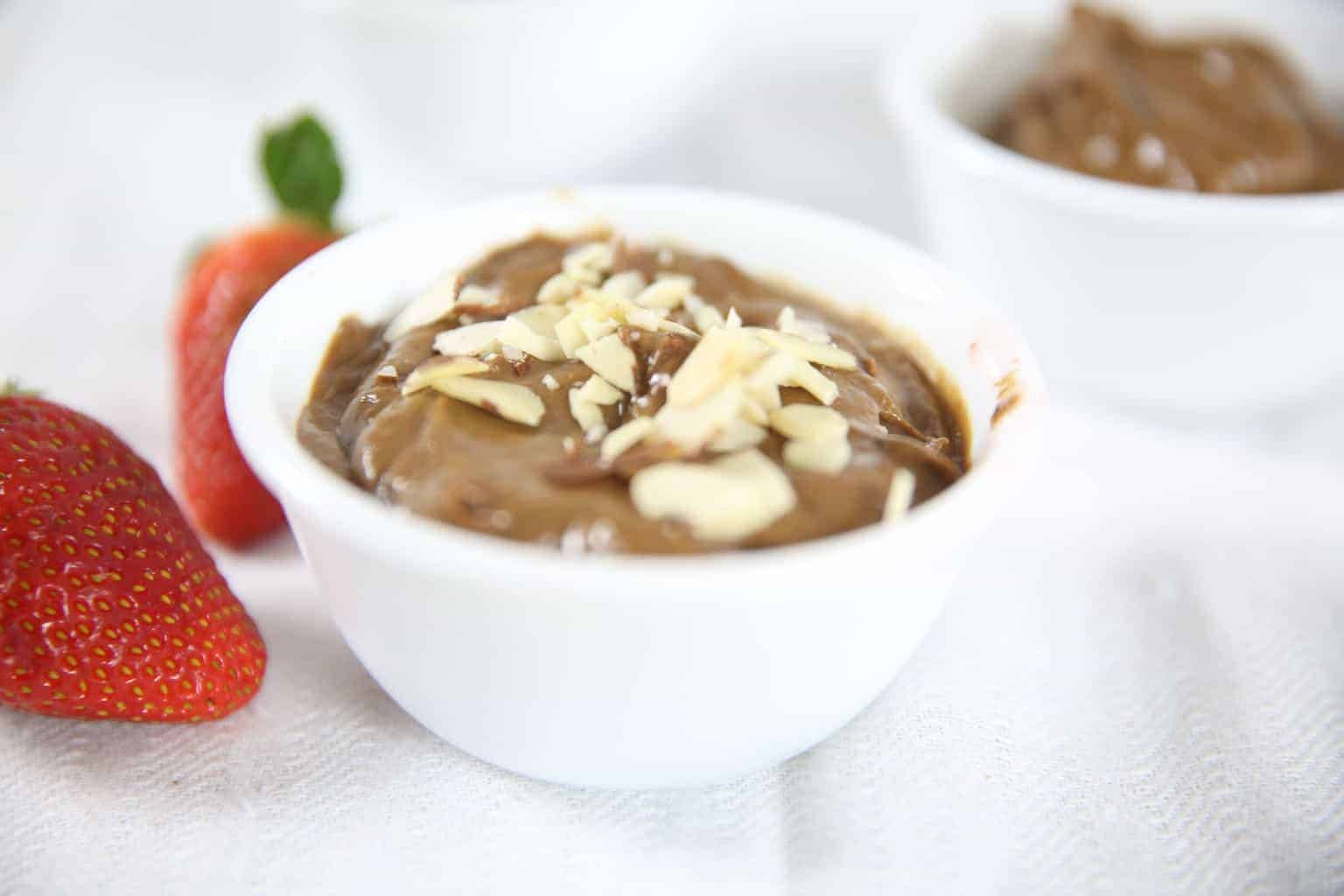 Peanut butter avocado pudding can be topped with almonds, strawberries, shredded coconut for a healthy snack or breakfast.