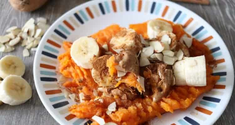 This delicious loaded sweet potato is whole 30 and paleo approved and a perfect snack for the whole family. Baked sweet potatoes with bananas, cinnamon, almonds, and almond butter.