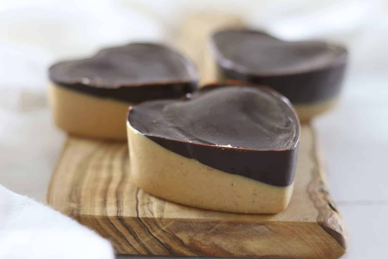 Paleo peanut butter hearts for a perfect Valentine's Day treat. Simple, healthy, and delicious dessert idea.