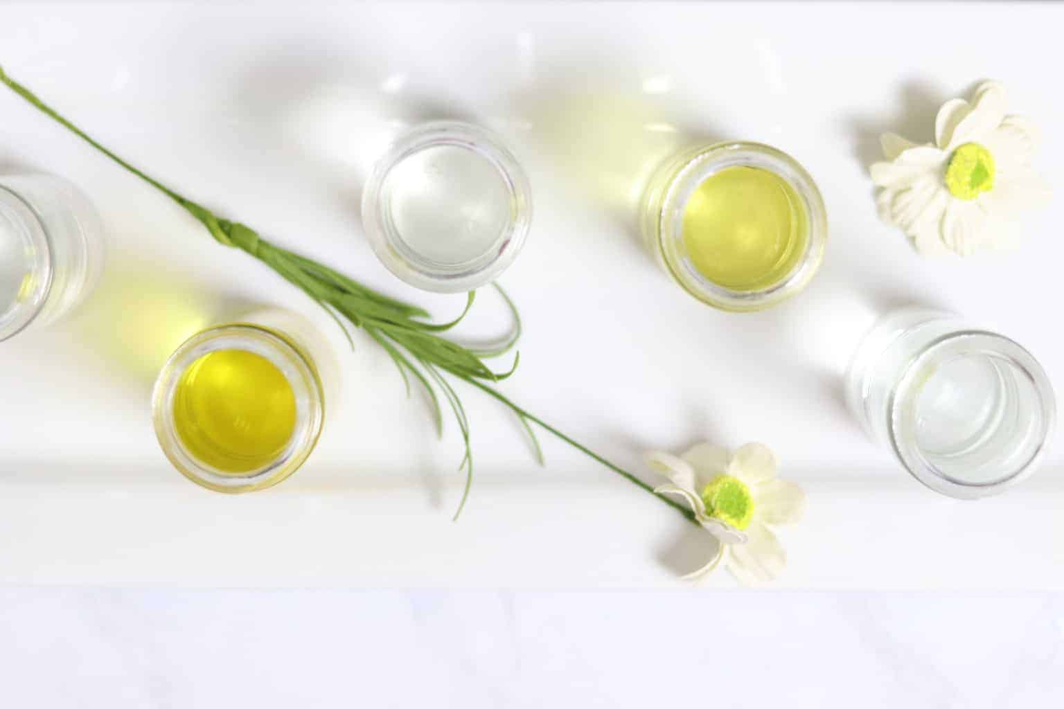 How to dilute essential oils with carrier oils. Fractionated coconut oil, olive oil, grasped oil, rose rip oil. and jojoba oil make the best carrier oils for essential oil roller bottles.