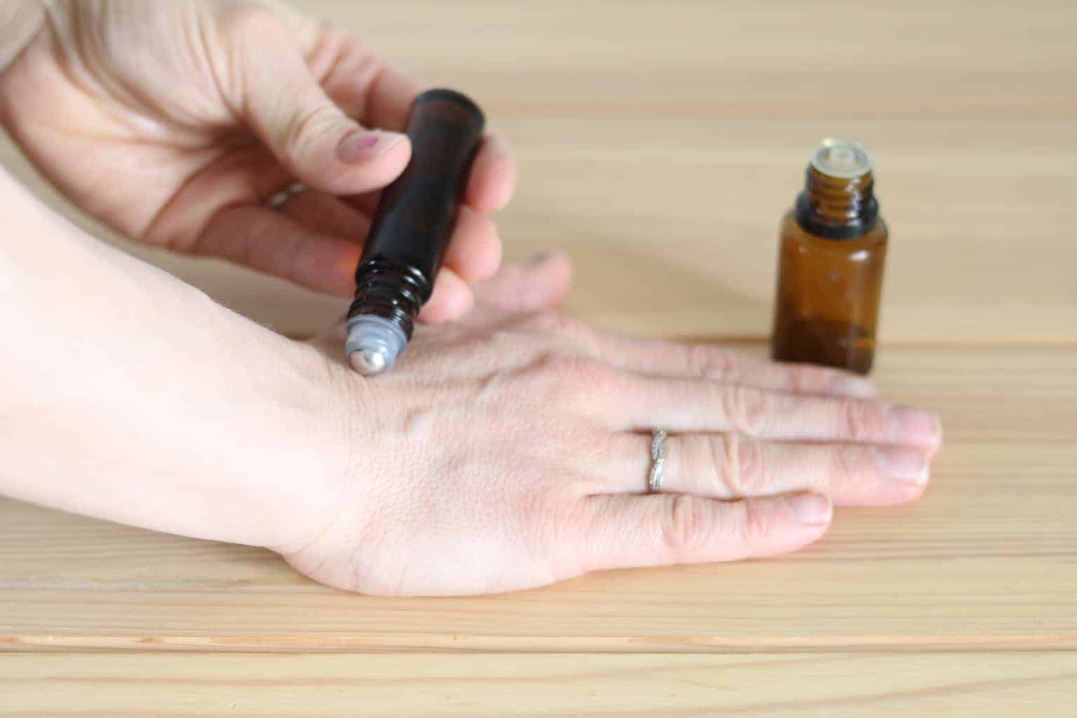 to make an essential oil roller bottle add 15-20 drops of essential oil to a amber color, glass, 10mL roller bottle. Then top off with a carrier oil. Apply topically to area of concern as needed.