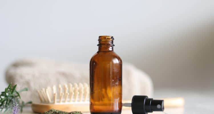 Learn how to make a nourishing hair serum with this simple recipe using nettle tea, essential oils, and aloe.