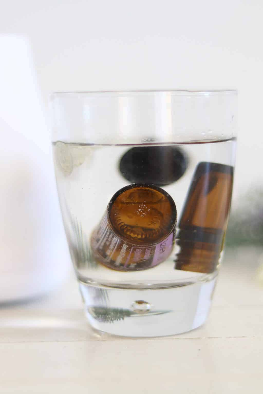 When your essential oil bottle is empty take the lid off and dropper top off and put it into a cup of water. Then put the empty bottle in upside down. This oil hack will assure you that you have every last drop of oil out and then you can use this water for your next diffuser blend.