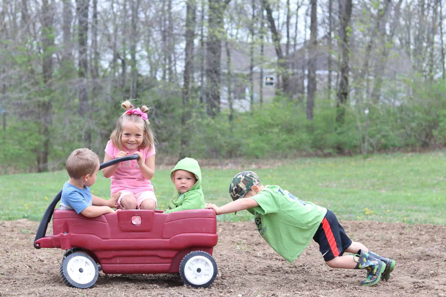 4 kids playing outside for play time before starting homeschool, day in the life with kids
